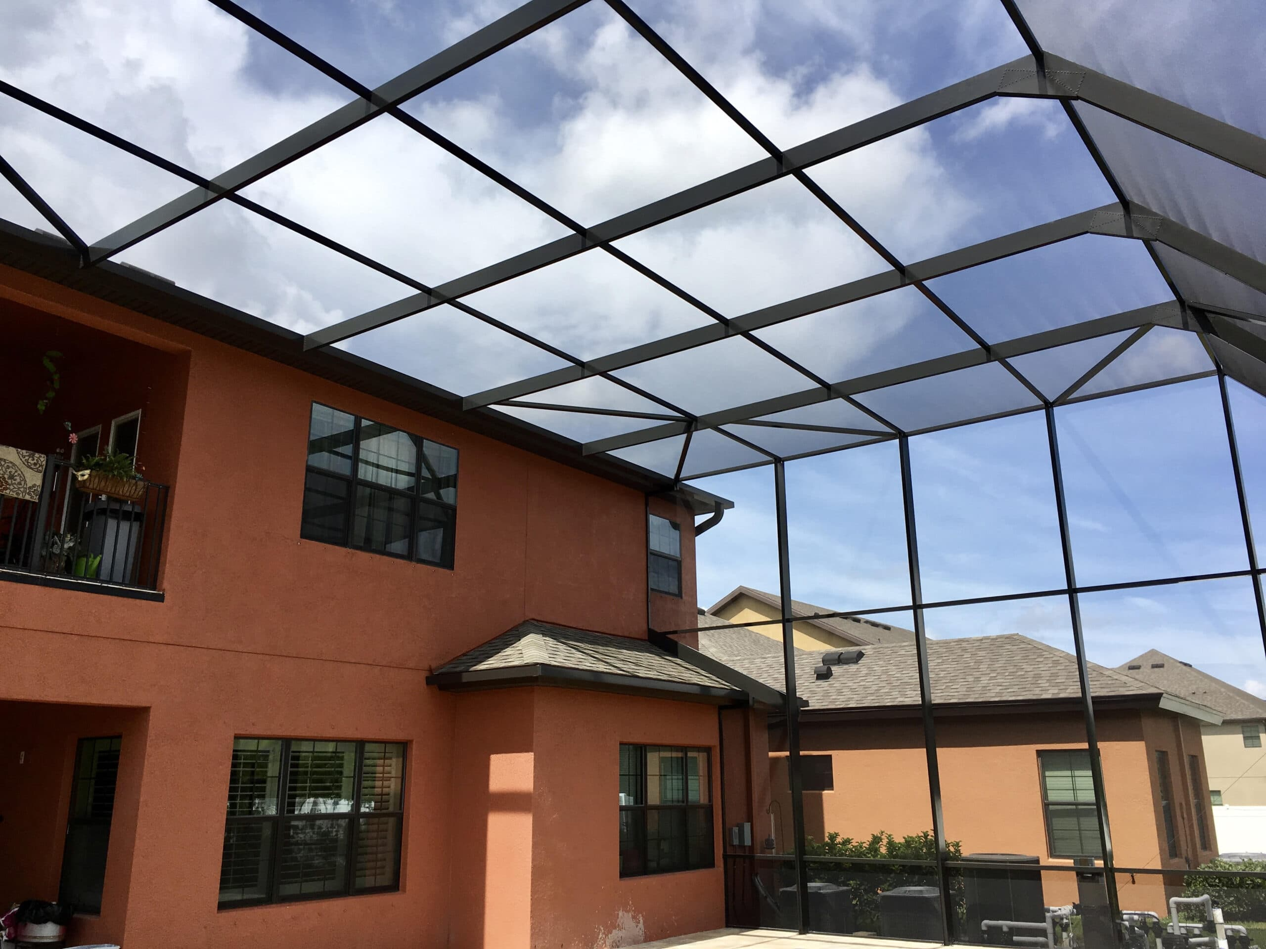 two story pool enclosure with half mansard screen roof