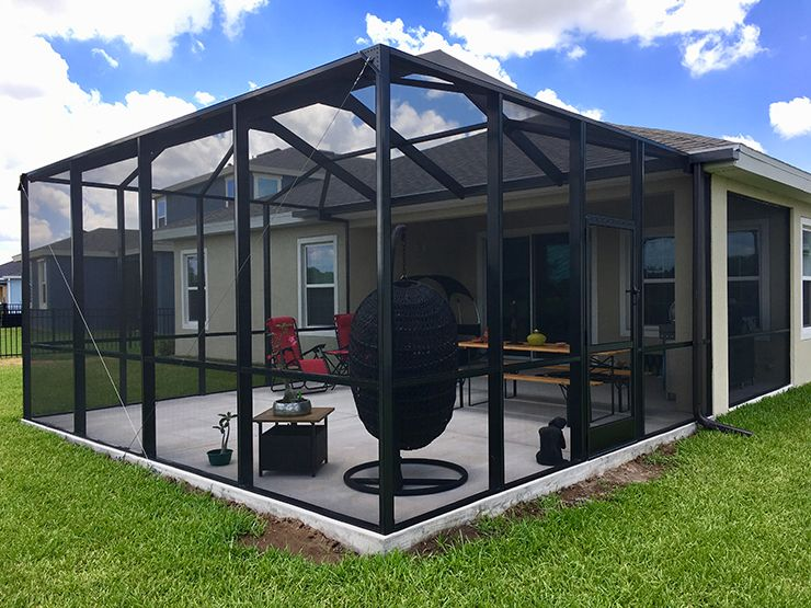 Newly built bronze screen enclosure bird cage with concrete patio.