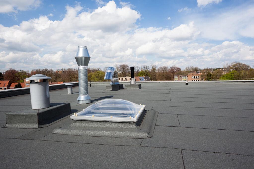 Roll roofing on commercial building with skylight