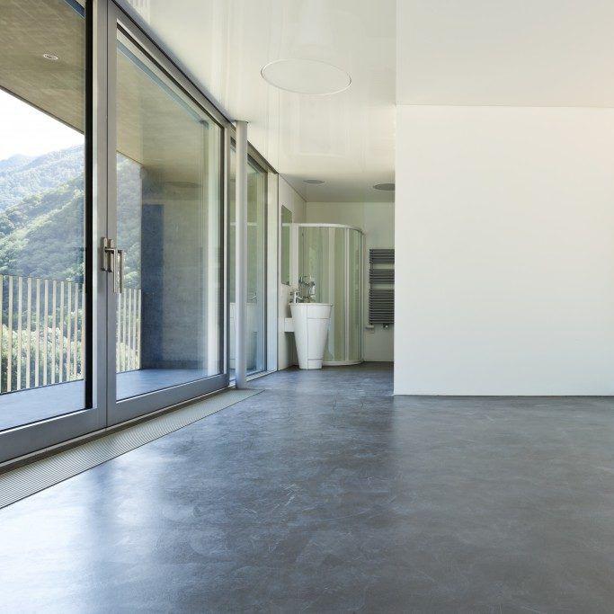Highly reflective concrete floor inside studio apartment