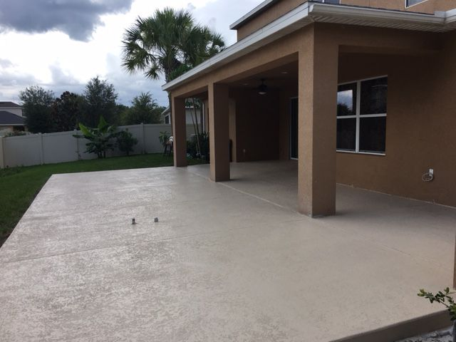 Concrete patio with spray texture and tan sealer