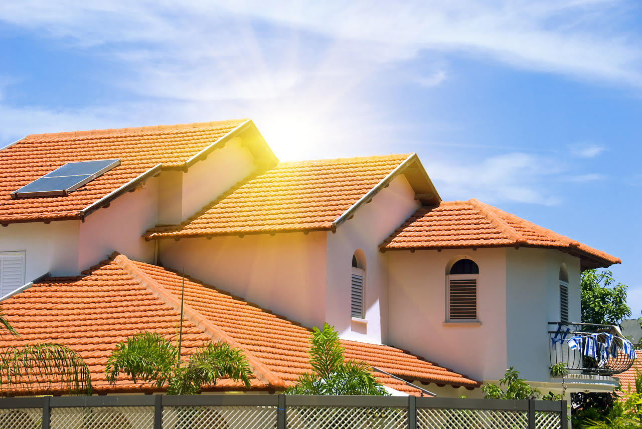 Terra cotta tile roof with blue sky and sun shine