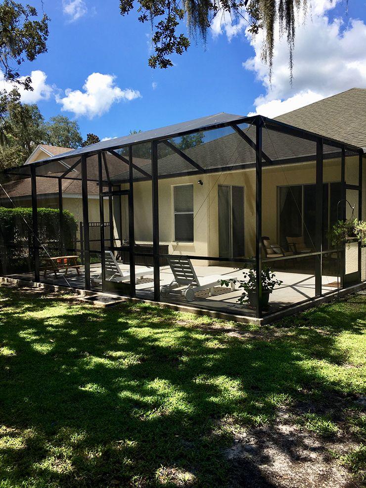 Beautiful screen enclosure bronze with concrete patio