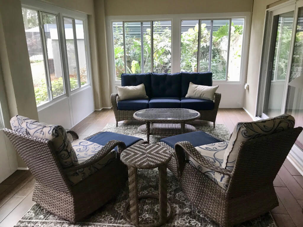 Conditioned sunroom glass room Florida room fully furnished in Florida