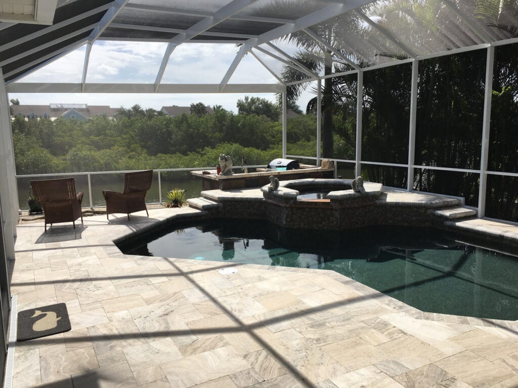 Clear view white pool enclosure with travertine paver pool deck