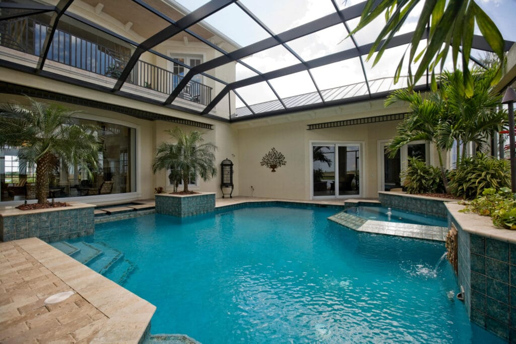 Tropical pool enclosure with beautiful blue pool water
