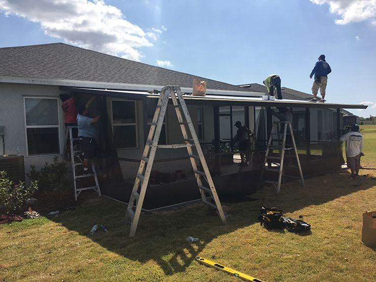 Contractors building a screen room