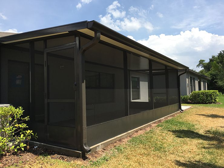 """Screen room with 16"""" kick panel gutters and insulated roof"""